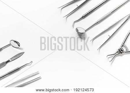 dentistry with dentist tools close up on white hospital desk background top view space for text