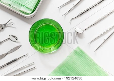 dentist office with medical tools for teeth care on white background top view