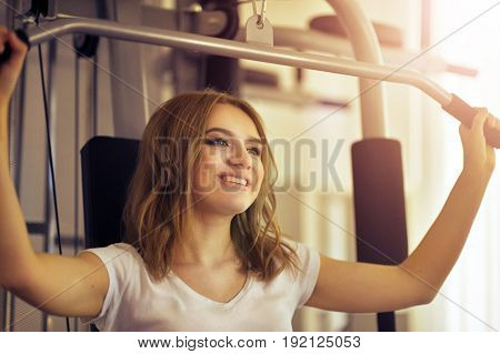 Sporty young woman training in a gym