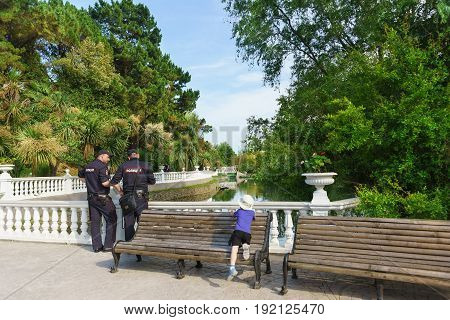 Sochi, Krasnodar Krai, Russia - June 06.2017: Two Policemen Stand Near A Pond In The Dendrological P