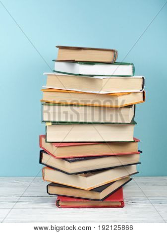 Open book, hardback colorful books on wooden table. Back to school. Copy space for text. Education business concept