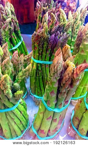 groups of banded asparagus at the market