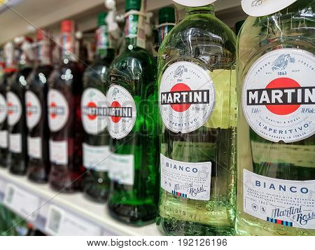 Nowy Sacz Poland - June 16 2017:Bottles of various types of Martini Bianco Vermouth on store shelves for sale in Tesco Hypermarket. Martini is a brand of Italian vermouth named after the Martini
