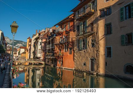 Annecy, France - June 28, 2016. Bridge and old building facing the canal at sunset, in the city center of historic Annecy, department of Haute-Savoie, Auvergne-Rhône-Alpes region, south-eastern France