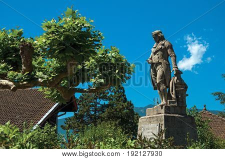Talloires, France - June 29, 2016. Statue with trees in the lovely village of Talloires, near the Lake of Annecy. Department of Haute-Savoie, Auvergne-Rhône-Alpes region, south-eastern France