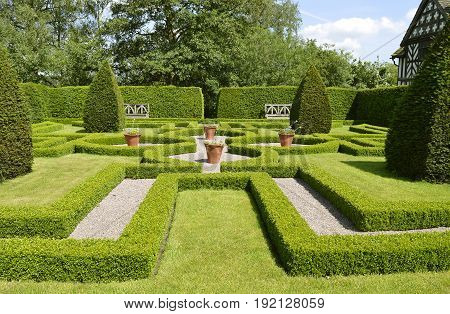 Congleton; Cheshire; England United Kingdom - June 17 2017 : Little Moreton Hall Knot garden the formal layout of knot gardens created tranquil spaces to get away from the bustle of the Tudor household