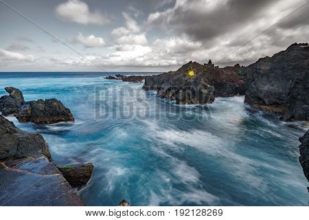 Wide angle long exposure of Biscoitos with volcanic rocks in Terceira Island, Portugal