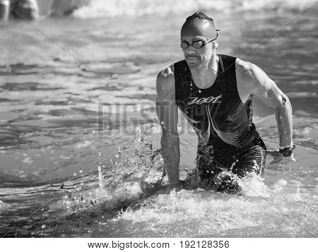 Pescara, Italy - June 18, 2017: Arrival of the first athletes at the end of the swimming test at Ironman 70.3 in Pescara