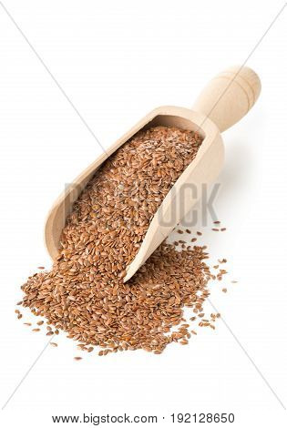 Raw unprocessed linseed or flax seed in wooden scoop over white background