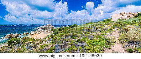 Walking path along sandstone rocksy coastline of Costa Serena, Sardinia, Italy.