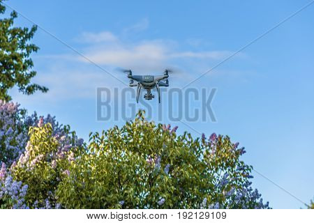 Drone quad copter with digital camera on the sky.