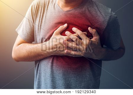 Adult male with heart attack or heart burn condition health and medicine concept
