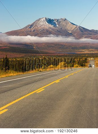 Travelers are provided with asphalt to travel Alaska wild places