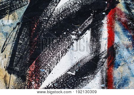 Abstract grunge urban background paint strokes on the wall surface