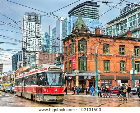 Toronto, Canada - May 2, 2017: Old streetcar on a street of Toronto. The Toronto streetcar system is the largest and the busiest light-rail system in North America