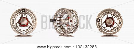 Fly Reel gold on white background. Fly reel for fly fishing. Fly reel close-up.