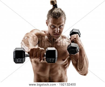 Powerful man doing boxing exercises making direct hit with dumbbells. Photo of sporty muscular male on white background. Strength and motivation