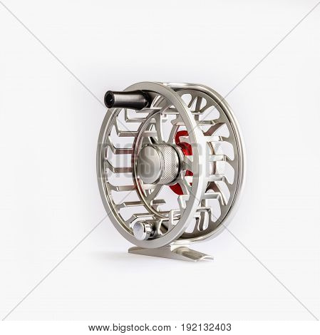 Fly Reel silver on white background. Fly reel for fly fishing. Fly reel close-up.