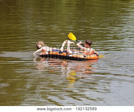 Two Boys Having Fun on Inflatable Rubber Boat in Summer