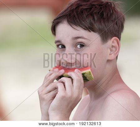 Boy with Brown Hair Eating Watermelon Outdoor
