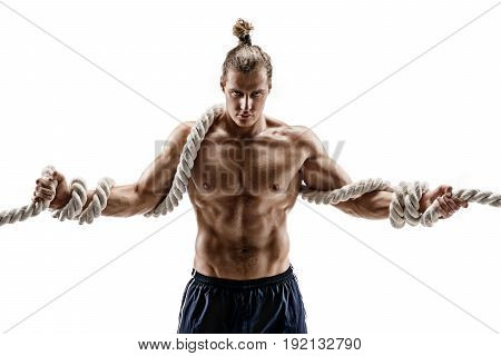 Handsome man with heavy ropes. Photo of attractive man shirtless isolated on white background. Strength and motivation