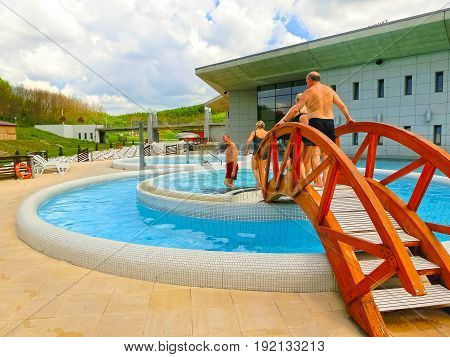 Egerszalok, Hungary - May 05, 2017: The people resting at pool at Saliris resort. The Egerszalok spa pools contain water rich in calcium, magnesium, and hydrocarbonate minerals at Egerszalok, Hungary on May 05, 2017.