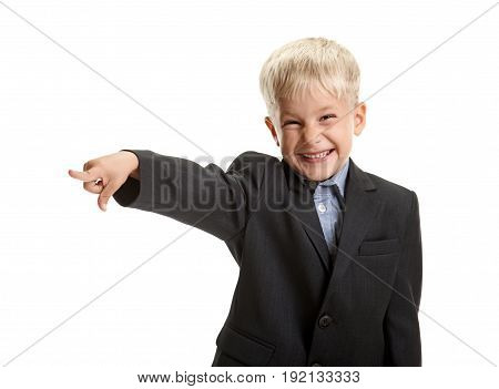 Little happy laughing schoolboy gesturing with finger