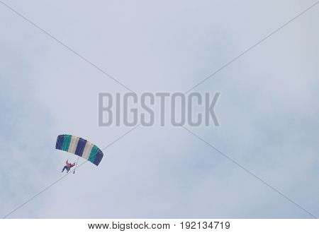 Sky Diver With Brightly Coloured Open Parachute - Text Area Available