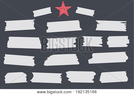 White different size adhesive, sticky tape, paper pieces with red star on black background