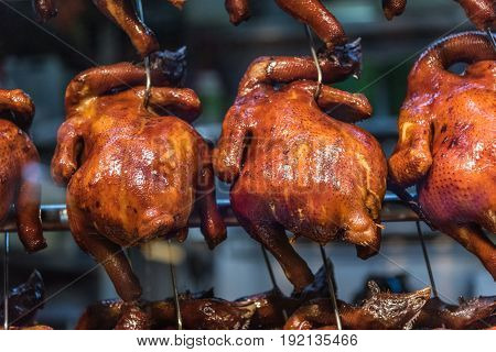 Closeup shot on roast chicken hanging in a hawker stall