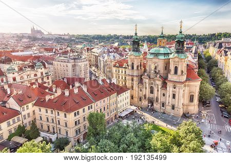 PRAGUE, CZECH REPUBLIC - MAY 2017: St Nicholas Church at Old Town Square in Prague during sunset.