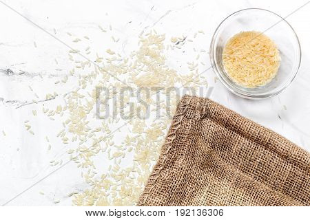homemade paella ingredients composition with ricein bowl on white kitchen table background top view mock-up