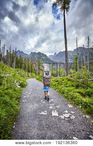 High Tatra Mountains Slovakia - June 15 2017: Mountain porter carrying heavy food supply to one of mountain huts.