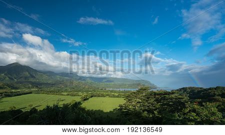 View over Hanalei bay and Na Pali range after a storm with rainbow near Hanalei, Kauai, Hawaii