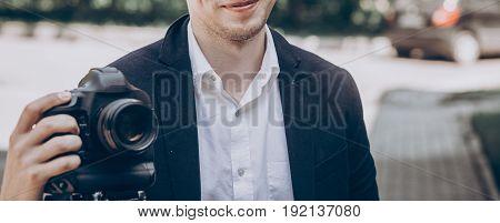 Stylish Man Holding Photo Camera. Professional Holding Video Camera At Wedding Ceremony, Photographe