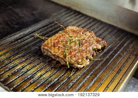 Grilled beef steak on the grill, close-up