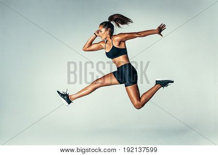 Fit Young Woman Jumping In Air