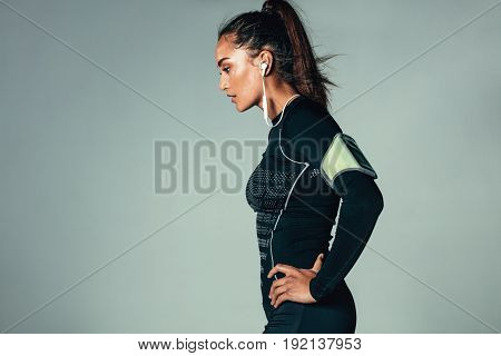 Fit Young Woman Standing With Hands On Hips