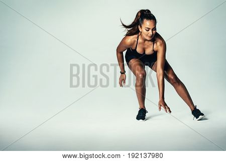 Fitness Woman Running Over Grey Background