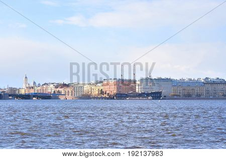 View of Neva River and Mytninskaya quay on Petrograd side in center of St.Petersburg at sunny spring day Russia.