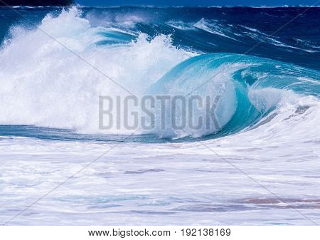 Cresting ocean waves taken with high shutter speed to show droplets of water in the surf