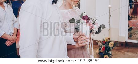 Stylish Wedding Bride And Groom Holding Big Candle. Modern Couple With Candle  Light, Family Traditi