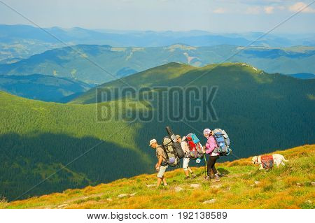 Group Of Hikers At Mountains