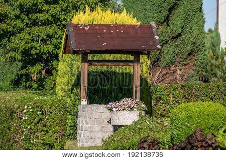 Retro Stone Well In The Beautiful Garden Of Germany