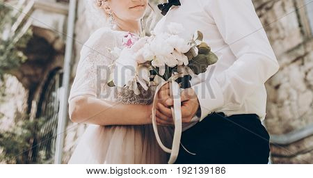 Stylish Wedding Bouquet. Modern Bride And Groom Holding Fashionable Bouquet Close Up In Park. Fine A