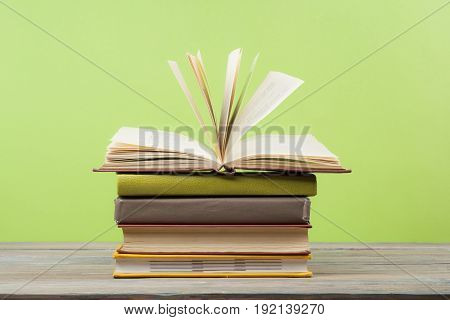 Open book, hardback books on wooden table. Education background. Back to school.