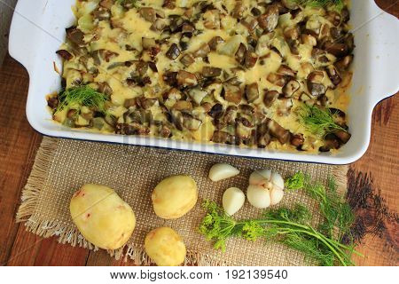 dish from fried pieces of eggplants in processed cheese