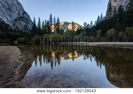 Early moring reflections of the Mountains in Mirror Lake, Yosemite National Park.