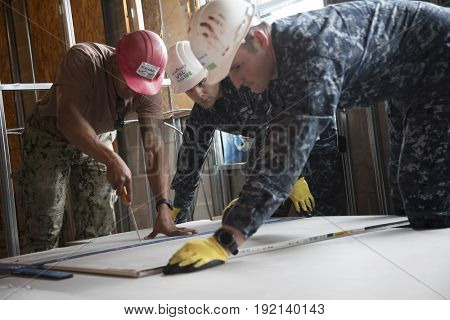 US Navy Seabees and sailors based in Norfolk, VA help Habitat for Humanity NYC on a home building project in the Brownsville section of Brooklyn during Fleet Week New York, NEW YORK MAY 25 2017.