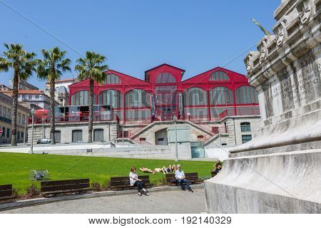 PORTO, PORTUGAL - April 17, 2017: People at Old Town streets of Porto. Porto is the famous tourist destiantion in Portugal